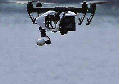 Camera Equipped Drone Overflying Water